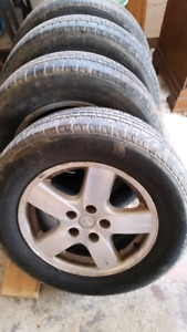 4 all season 215/65R16 tires with dodge rims