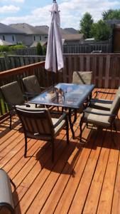 Patio set with 6 chairs, cushions and umbrella