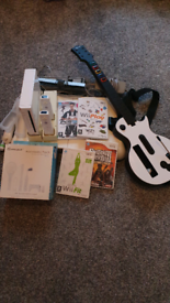 Wii plus fitboard and Guitar hero 3