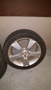 Mazda Aloy Rims 5x114.3 with all season tires 205-50-17