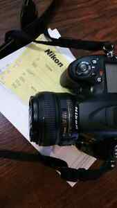 NIKON d7100 camera and 50mm 1.8G lens. obo