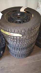 LIKE BRAND NEW Cooper snow tires on wheels 235/65/R17