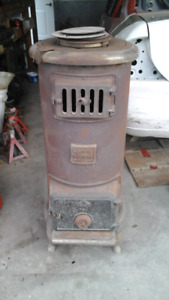 Gurney wood stove with chimney piping