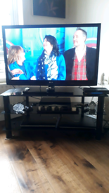 42 inch Lg tv with black glass stand with remote