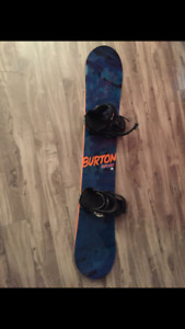 Burton snowboard and bindings with Dakine bag.