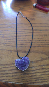 Real amethyst pendant with black leather cord.