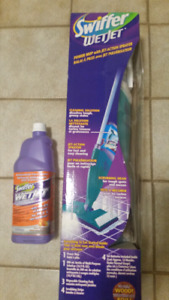 Swiffer wetjet cleaning up kit bonus refill bottle.