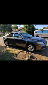 2009 Toyota Camry Hybrid. Also selling new road bike