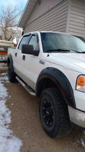 2005 Ford F-150 XLT With heated Leather Seats and more.