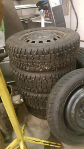 """4x14"""" studded winter tires on rims"""