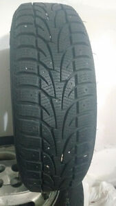 4 like new winter tires on 4 bolt rims. 185/65R15 London Ontario image 2