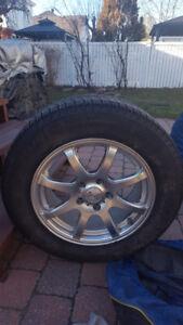 4 pneus d'hiver Michelin X Ice 205/65R16 avec Mags