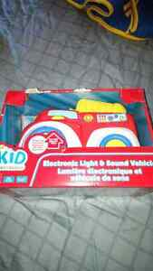 $5. Brand New in Box. Plays music, sounds and has lights