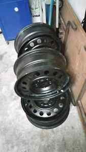 15x6 4x100mm from 2005 kia spectra5 Steel Wheels (4) West Island Greater Montréal image 3