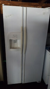 2 white side by side fridges 200.00 each Delivery available