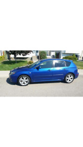 Mazda 2008.  162000KMS.  Heated seats.  Summer and winter tires.