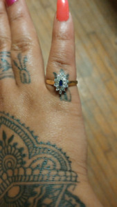$250 O.B.O. gold diamond and blue sapphire ring