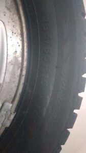 4 like new winter tires on 4 bolt rims. 185/65R15 London Ontario image 3
