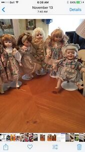 12 PORCELAIN COLLECTABLE DOLLS