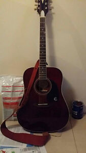 q stick guitar one brass and two picks with strap