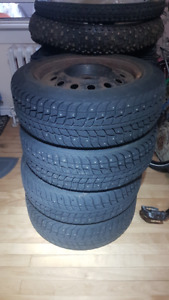 4 x 15inch Studded winter tires on rims (4x100 bolt pattern)