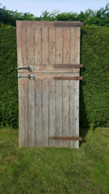 Stable or Workshop doors with hinges and bolts.