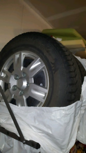 Winter tires on rims with hubcaps 235/70/16