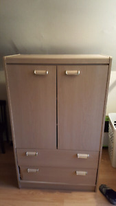 Beautiful wardrobe with hidden storage on the top!