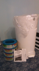 Brand new diaper genie with lots of refills!