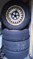 215/70/16 Firestone Winterforce studded tires with rims