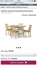 BRAND NEW wood table and chairs