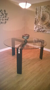Modern, round glass top table (Structube)