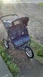 Double baby trend jogging stroller and brand new baby gate.