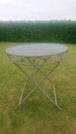 Ornate metal patio table
