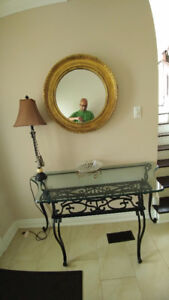 hall way rod iron table and mirror