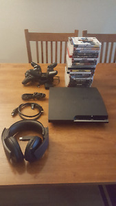 320Gb Ps3 slim with 18 games, 3 controllers, and Sony headset