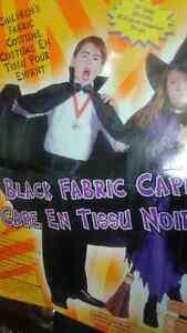 Child's black fabric cape.