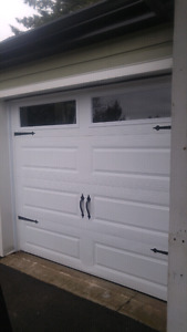 Garaga 1 year old 8x7  garage door un insulated