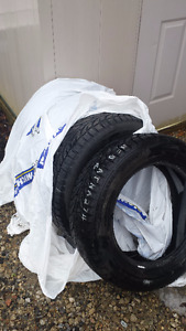4 snow tires for sale - 2 seasons old - Pictures attached