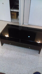 Dark brown with black glass top coffee table