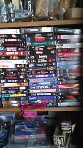 Hundred of VHS movies a wall full. Dollar each.