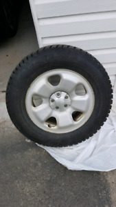 STUDDED WINTER TIRES ON RIMS WITH CENTRES
