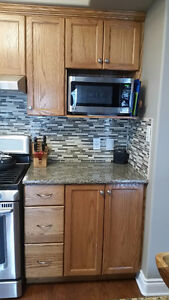 Oak cabinets, kitchen and island, granite tops sink and faucet