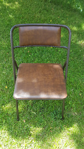 4 brown folding chairs