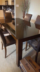 Lovely glass topped dining table with six chairs and sideboard