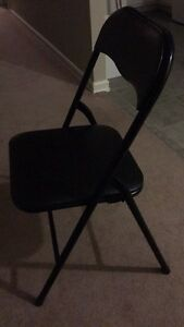 Black foldable chairs like new for sale
