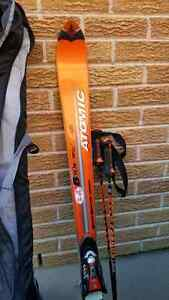 Atomic 170' 10.20 skis, boots, poles and bag