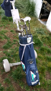 Mens and womens golf clubs with carts