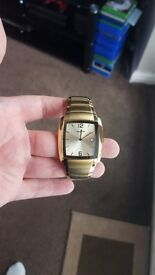 Gents gold colored Accurist watch.