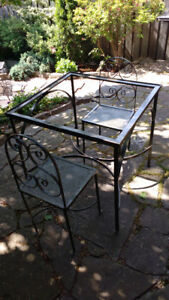 Indoor/outdoor 3 piece glass top table and chairs